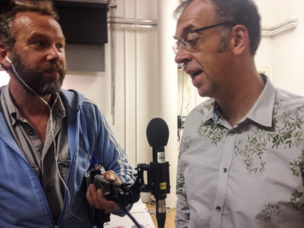 Radio 4's Miles Warde speaks to Colin McPherson, at the Common ground photography exhibition at Street Level Photoworks,  in Glasgow, Scotland 28 August 2014