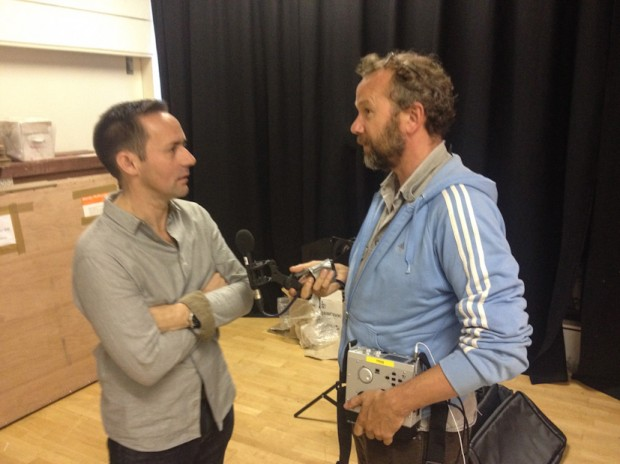 Radio 4's Miles Warde speaks to Jeremy Sutton-Hibbert, at the Common Ground photography exhibition at Street Level Photoworks,  in Glasgow, Scotland 28 August 2014